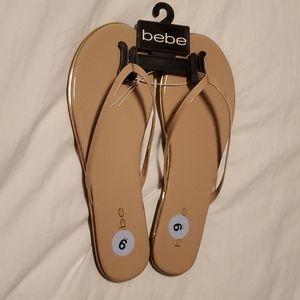 BeBe beige and gold flip flops